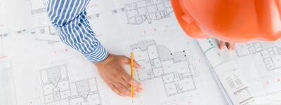 Architect working with technical drawings